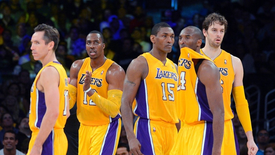FILE - In this Oct. 21, 2012, file photo, Los Angeles Lakers, from left, Steve Nash, Dwight Howard, Metta World Peace, Kobe Bryant and Pau Gasol, of Spain, pause during the second half of a preseason NBA basketball game against the Sacramento Kings in Los Angeles. Just three years removed from their last championship, the Lakers are a team in transition.(AP Photo/Mark J. Terrill, File)