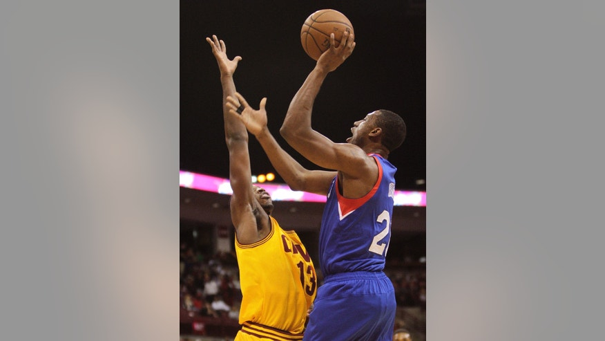 Philadelphia 76ers' Thaddeus Young, right, shoots over Cleveland Cavaliers' Tristan Thompson during the first quarter of an NBA preseason basketball game Monday, Oct. 21, 2013, in Columbus, Ohio. (AP Photo/Jay LaPrete)