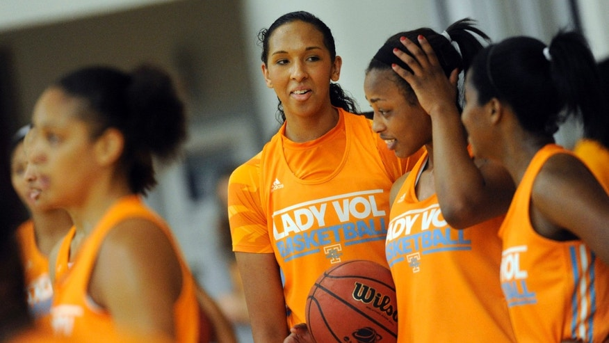 FILE - In this Oct. 1, 2013, file photo, Tennessee freshman Mercedes Russell, center, gathers with teammate during NCAA college basketball practice in Knoxville, Tenn. Russell grew up rooting for Candace Parker and the Lady Vols. Now the 6-foot-6 freshman is about to begin her college career as Tennessee's most heralded incoming recruit since Parker's arrival on campus. (AP Photo/Knoxville News Sentinel, Adam Lau, File)