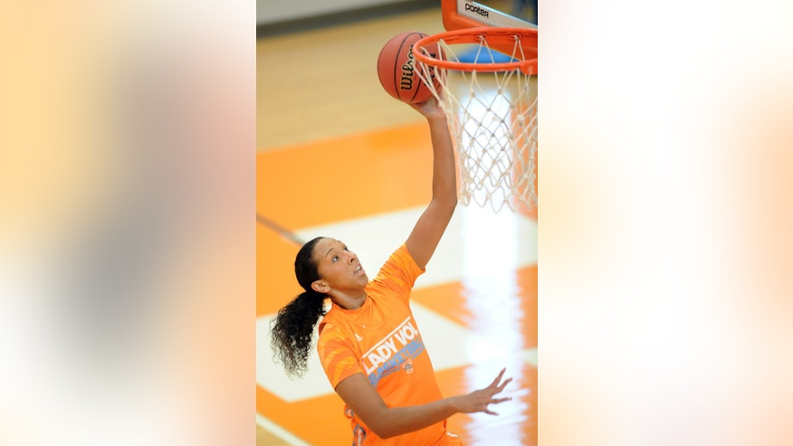 FILE - In this Oct. 1, 2013 file photo, Tennessee freshman Mercedes Russell shoots during NCAA college basketball practice in Knoxville, Tenn. Russell grew up rooting for Candace Parker and the Lady Vols. Now the 6-foot-6 freshman is about to begin her college career as Tennessee's most heralded incoming recruit since Parker's arrival on campus.  (AP Photo/Knoxville News Sentinel, Adam Lau, File)