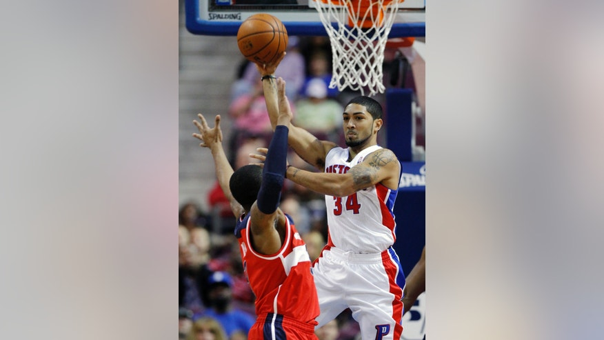 Detroit Pistons guard Peyton Siva (34) passes the ball against Washington Wizards guard Bradley Beal (3) during the first half of a preseason NBA basketball game Tuesday, Oct. 22, 2013, in Auburn Hills, Mich. (AP Photo/Duane Burleson)