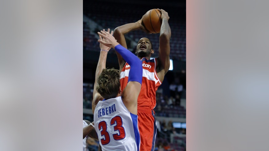 Washington Wizards forward Trevor Ariza takes a shot against Detroit Pistons forward Jonas Jerebko (33) during the first half of a preseason NBA basketball game Tuesday, Oct. 22, 2013, in Auburn Hills, Mich. (AP Photo/Duane Burleson)