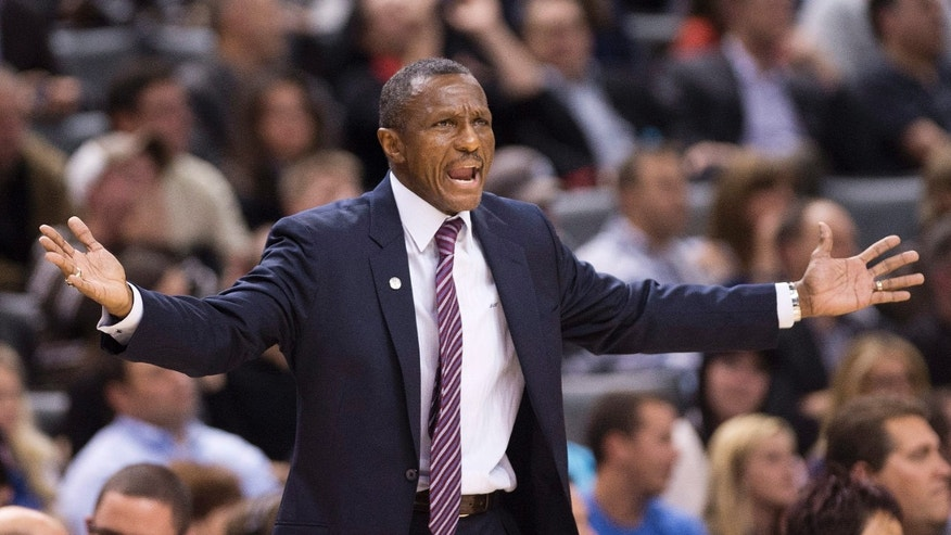 Toronto Raptors head coach Dwane Casey reacts while playing against the New York Knicks during second half NBA pre-season basketball action in Toronto on Monday, Oct. 21, 2013. (AP Photo/The Canadian Press, Nathan Denette)