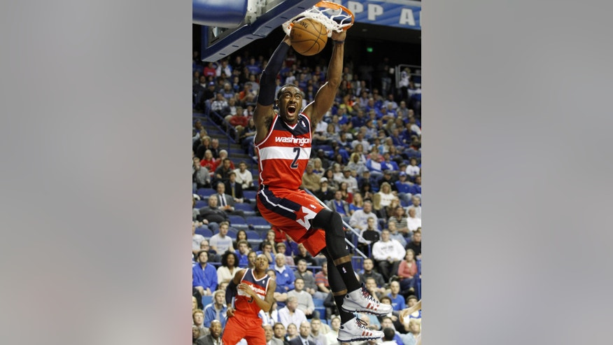Washington's John Wall dunks during an NBA basketball exhibition game against New Orleans, Saturday, Oct. 19, 2013, in Lexington, Ky. (AP Photo/James Crisp)
