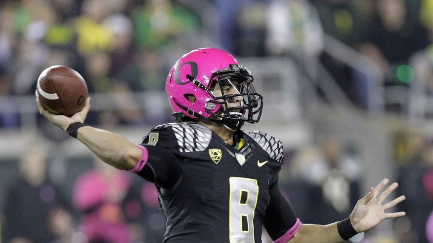 Oregon quarterback Marcus Mariota passes during the first half of an NCAA college football game against Washington State in Eugene, Ore., Saturday, Oct. 19, 2013. (AP Photo/Don Ryan)