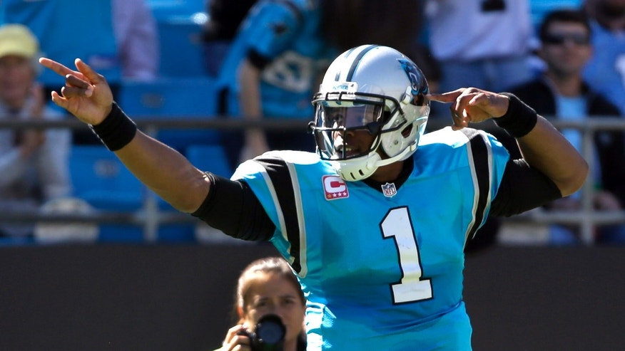 Carolina Panthers' Cam Newton (1) celebrates after running for a first down against the St. Louis Rams in the first half of an NFL football game in Charlotte, N.C., Sunday, Oct. 20, 2013. (AP Photo/Bob Leverone)