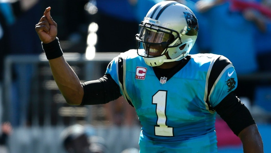 Carolina Panthers' Cam Newton (1) tries to fire up the crowd in the second half of an NFL football game against the St. Louis Rams in Charlotte, N.C., Sunday, Oct. 20, 2013. (AP Photo/Bob Leverone)