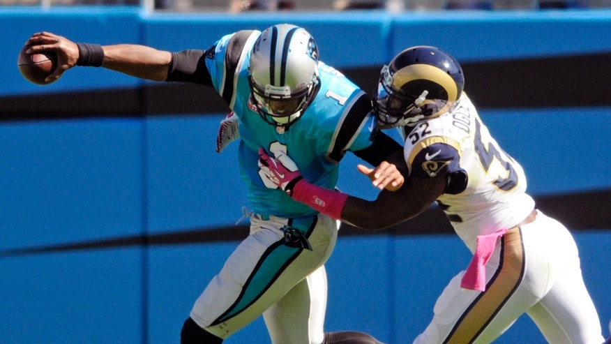 Carolina Panthers' Cam Newton, left, is sacked by St. Louis Rams' Alec Ogletree (52) in the second half of an NFL football game in Charlotte, N.C., Sunday, Oct. 20, 2013. (AP Photo/Mike McCarn)