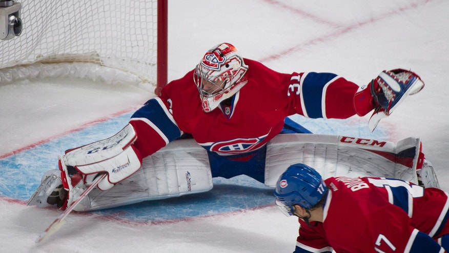 Montreal Canadiens' goaltender Carey Price is scored on by the Edmonton Oilers' Ladislav Smid  as Canadiens' Rene Bourque defends during the second period of an NHL hockey game in Montreal, Tuesday, Oct. 22, 2013. (AP Photo/The Canadian Press, Graham Hughes)