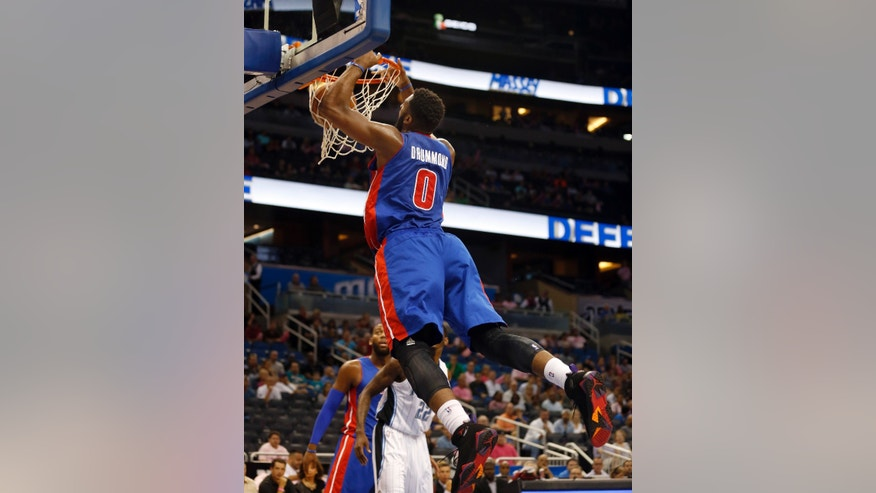 Detroit Pistons center Andre Drummond (0) dunks the ball during the first half of an NBA basketball game against the Orlando Magic on Sunday,  Oct.  20, 2013, in Orlando, Fla.. The Magic won 87-86. (AP Photo/Reinhold Matay)