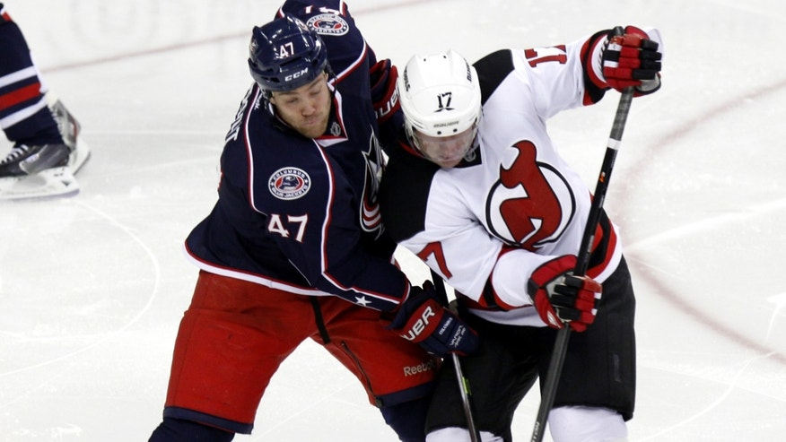 New Jersey Devils' Michael Ryder, right, works for the puck against Columbus Blue Jackets' Dalton Prout in the third period of an NHL hockey game in Columbus, Ohio, Tuesday, Oct. 22, 2013. The Blue Jackets won 4-1. (AP Photo/Paul Vernon)