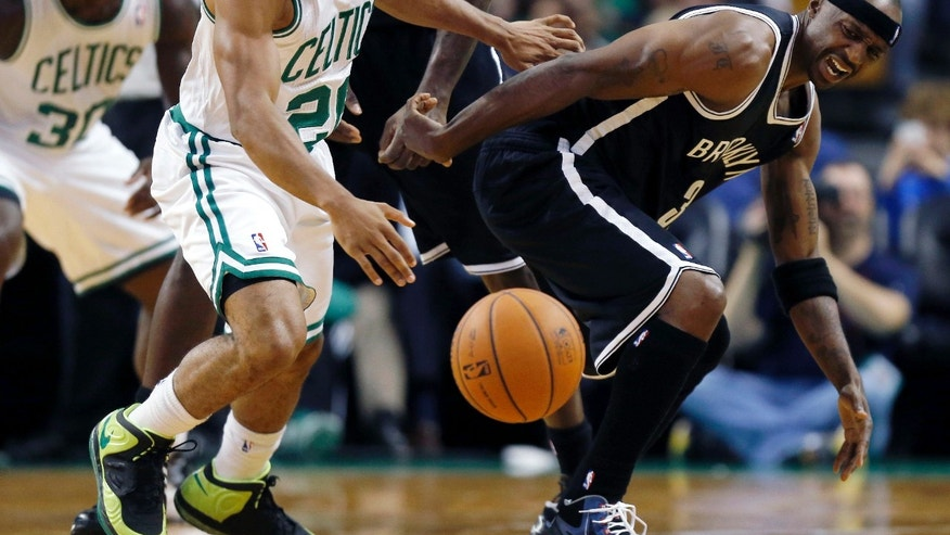 Boston Celtics' Phil Pressey (26) and Brooklyn Nets' Jason Terry (31) battle for a loose ball in the second quarter of a preseason NBA basketball game in Boston, Wednesday, Oct. 23, 2013. (AP Photo/Michael Dwyer)