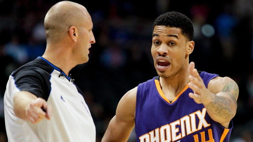 Referee Eric Dalen, left, listens to Phoenix Suns' Gerald Green, right, after calling a foul on him during the first quarter of an NBA basketball preseason game against the Denver Nuggets, Wednesday, Oct. 23, 2013, in Denver. (AP Photo/Barry Gutierrez)