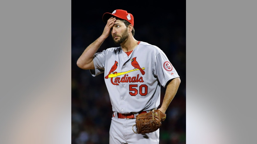St. Louis Cardinals starting pitcher Adam Wainwright wipes his face as he pitches to Boston Red Sox's Mike Napoli during the second inning of Game 1 of baseball's World Series Wednesday, Oct. 23, 2013, in Boston. (AP Photo/Matt Slocum)