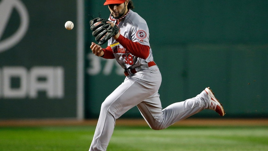 St. Louis Cardinals shortstop Pete Kozma cannot make a play on a ball hit by Boston Red Sox's Shane Victorino during the second inning of Game 1 of baseball's World Series Wednesday, Oct. 23, 2013, in Boston. (AP Photo/Matt Slocum)