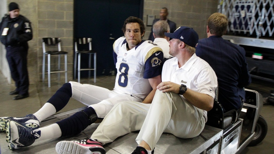 In this Oct. 20, 2013 photo, St. Louis Rams' Sam Bradford (8) is taken to the locker room after being injured in the second half of an NFL football game against the Carolina Panthers in Charlotte, N.C. Bradford will miss the rest of the season because of a torn knee ligament. The Rams said Monday, Oct. 21, 2013, the extent of the injury to Bradford's left knee was confirmed after an MRI exam. Bradford tore his anterior cruciate ligament in the fourth quarter of Sunday's 30-15 loss to the Panthers when he landed on his knee after being shoved out of bounds by Panthers safety Mike Mitchell. (AP Photo/Chuck Burton)