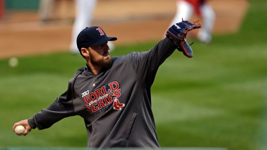 Boston Red Sox pitcher John Lackey throws during a baseball workout Tuesday, Oct. 22, 2013, in Boston. The Red Sox are scheduled to host the St. Louis Cardinals in Game 1 of baseball's World Series on Wednesday. (AP Photo/Charles Krupa)