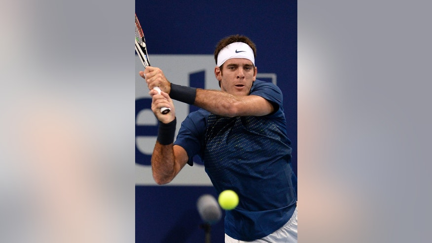 Argentina's Juan Martin Del Potro returns a ball to Switzerland's Henri Laaksonen during their first round match at the Swiss Indoors tennis tournament at the St. Jakobshalle in Basel, Switzerland, on Wednesday, Oct. 23, 2013. (AP Photo/Keystone,Georgios Kefalas)