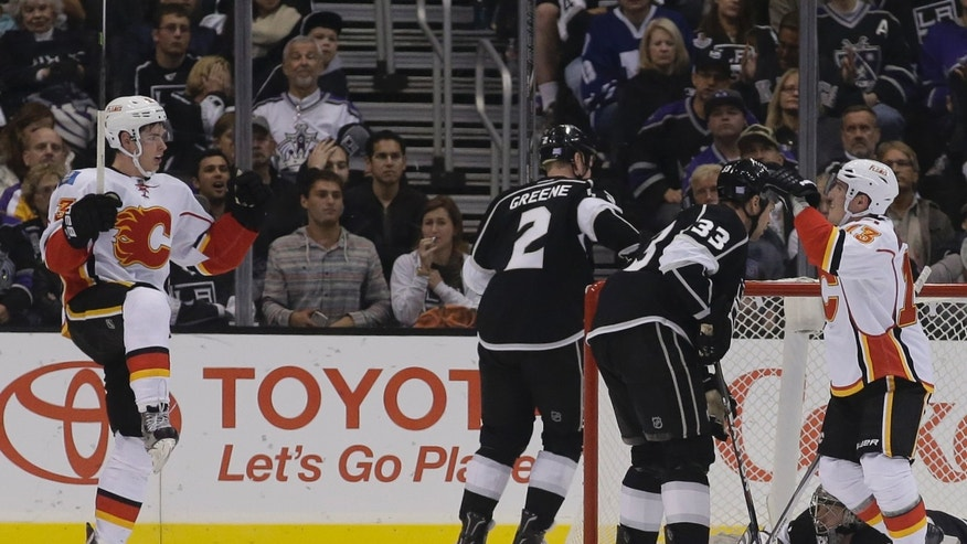 Calgary Flames center Sean Monahan, left, celebrates his goal with left wing Mike Cammalleri, right, against the Los Angeles Kings during the second period of an NHL hockey game in  Los Angeles, Monday, Oct. 21, 2013. (AP Photo/Chris Carlson)