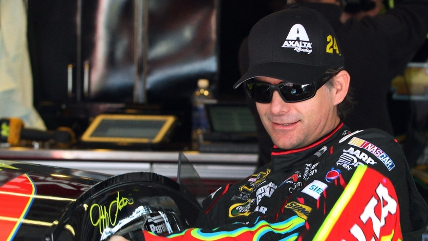FILE - In this Oct. 18, 2013, file photo, Jeff Gordon climbs into his car during practice for the NASCAR Sprint Cup Series auto race at Talladega Superspeedway in Talladega, Ala. Gordon got into the Chase for the Sprint Cup championship when NASCAR made an unprecedented move to expand the playoff field to 13 drivers after controversy at Richmond. Six weeks later, the focus finally seems to be back on the championship, instead of the shenanigans that occurred just before the 10-race Chase began.  (AP Photo/Jay Alley, File)