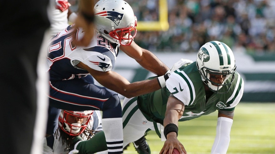 New York Jets quarterback Geno Smith (7) dives out of bounds during the second half of an NFL football game against the New England Patriots on Sunday, Oct. 20, 2013, in East Rutherford, N.J.  (AP Photo/Kathy Willens)
