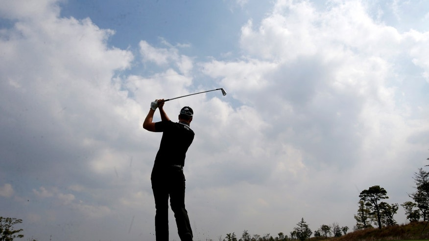 Henrik Stenson of Sweden tees off at the 2nd hole during a pro-am competition ahead of the BMW Masters golf tournament at the Lake Malaren Golf Club in Shanghai, China, Wednesday, Oct. 23, 2013. The European Tour event will begin on Oct. 24. (AP Photo/Eugene Hoshiko)