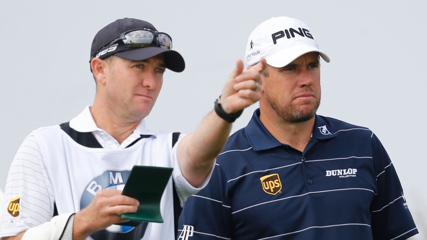 Lee Westwood of England, right, listens his caddie at the 2nd hole during a pro-am competition ahead of the Masters golf tournament at the Lake Malaren Golf Club in Shanghai, China, Wednesday, Oct. 23, 2013. The Shanghai Masters will begin on Oct. 24. (AP Photo/Eugene Hoshiko)