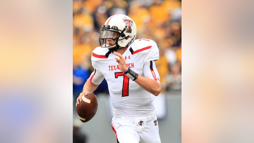 Texas Tech quarterback Davis Webb (7) rolls from the pocket during the second quarter of their NCAA college football game against West Virginia in Morgantown, W.Va., on Saturday, Oct. 19, 2013. (AP Photo/Chris Jackson)