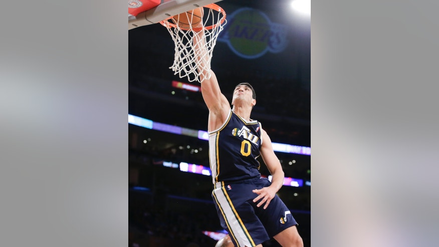Utah Jazz center Enes Kanter dunks against the Los Angeles Lakers during the first half of a NBA preseason basketball game in Los Angeles, Tuesday, Oct. 22, 2013. (AP Photo/Chris Carlson)