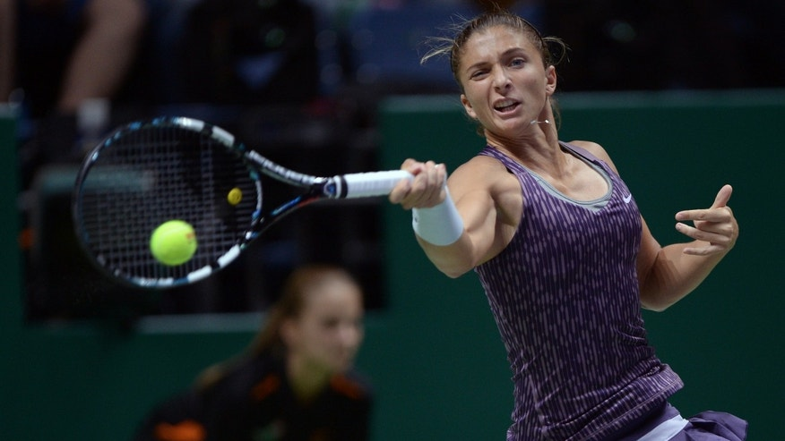 Sara Errani of Italy returns a shot to Li Na of China during their tennis match at the WTA championship in Istanbul, Turkey, Wednesday, Oct. 23, 2013. The world's top female tennis players compete in the championships which runs from Oct. 22 until Oct. 27.(AP Photo)