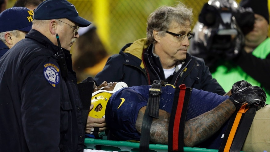 Green Bay Packers' Jermichael Finley is taken off the field on a stretcher after being injured after a catch during the second half of an NFL football game against the Cleveland Browns Sunday, Oct. 20, 2013, in Green Bay, Wis. (AP Photo/Tom Lynn)