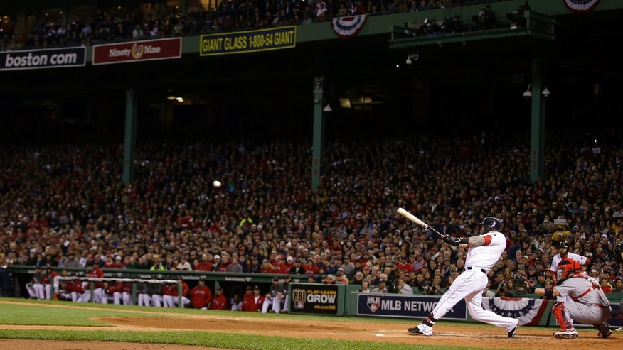 Boston Red Sox's Mike Napoli hits a three-run double during the first inning of Game 1 of baseball's World Series against the St. Louis Cardinals Wednesday, Oct. 23, 2013, in Boston. (AP Photo/Matt Slocum)