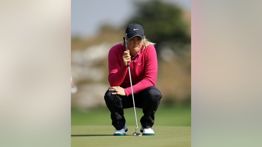 Suzann Pettersen of Norway lines up a putt on the sixth hole during the final round of the KEB Hana Bank Championship golf tournament at Sky72 Golf Club in Incheon, west of Seoul, South Korea, Sunday, Oct. 20, 2013. (AP Photo/Lee Jin-man)