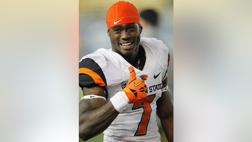 Oregon State wide receiver Brandin Cooks (7) gives a thumbs up to Oregon State fans from the sidelines during the final seconds against California in a NCAA college football game in Berkeley, Calif., Saturday, Oct. 19, 2013. Oregon State won 49-17.(AP Photo/Tony Avelar)