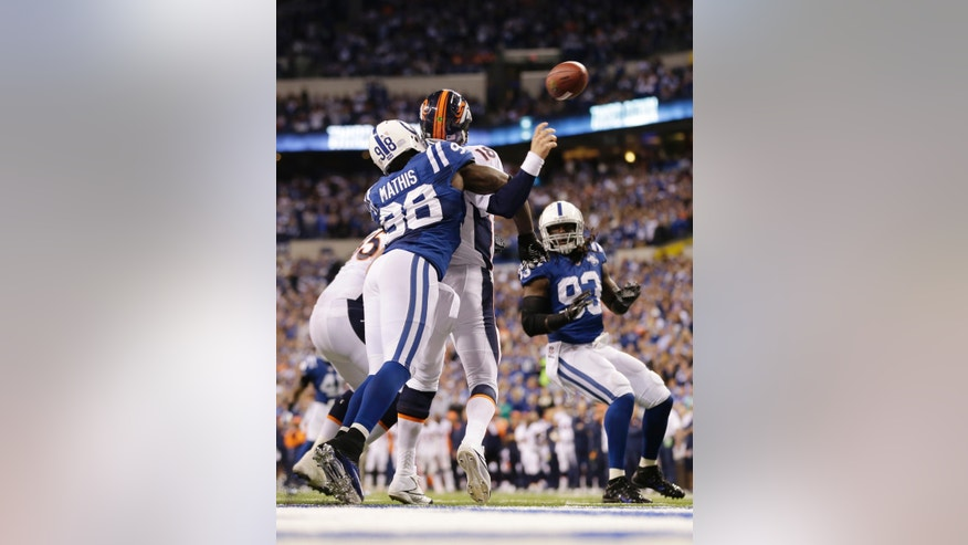 Denver Broncos quarterback Peyton Manning (18) loses the ball as Indianapolis Colts outside linebacker Robert Mathis (98) tackles him during the first half of an NFL football game, Sunday, Oct. 20, 2013, in Indianapolis. The officials ruled a safety on the play. (AP Photo/AJ Mast)