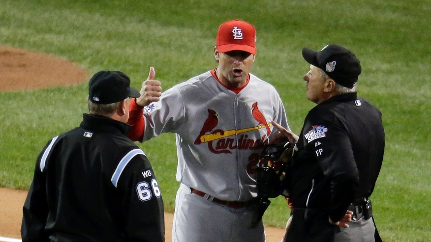 St. Louis Cardinals manager Mike Matheny argues a call during the first inning of Game 1 of baseball's World Series against the Boston Red Sox Wednesday, Oct. 23, 2013, in Boston. (AP Photo/Charlie Riedel)