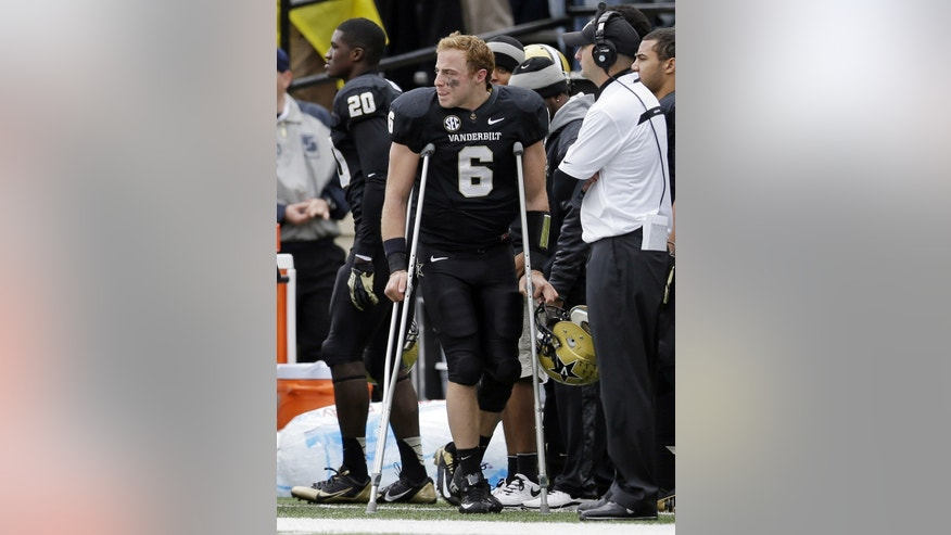 Vanderbilt quarterback Austyn Carta-Samuels (6) uses crutches as he watches the action in the fourth quarter of an NCAA college football game against Georgia on Saturday, Oct. 19, 2013, in Nashville, Tenn. Carta-Samuels was injured in the second quarter. Vanderbilt upset No. 15 Georgia 31-27. (AP Photo/Mark Humphrey)