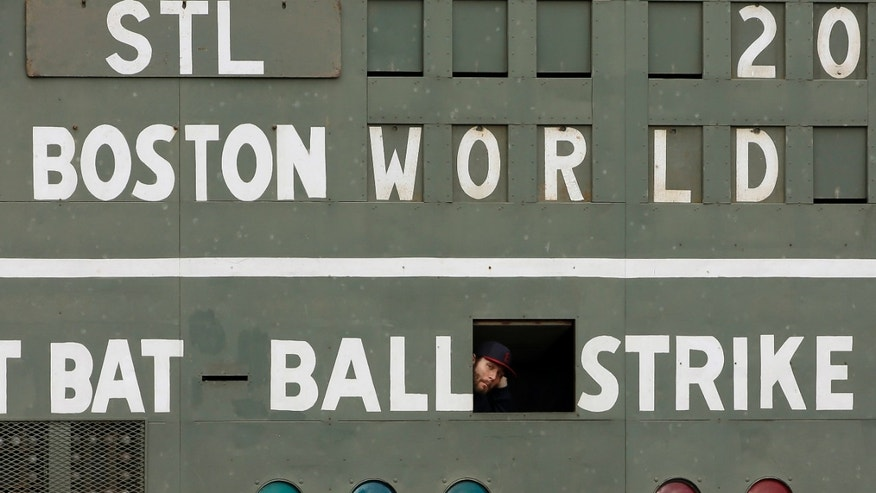 St. Louis Cardinals' Lance Lynn looks out of a scoreboard under the Green Monster before batting practice for Game 1 of baseball's World Series against the Boston Red Sox Tuesday, Oct. 22, 2013, in Boston. (AP Photo/David J. Phillip)