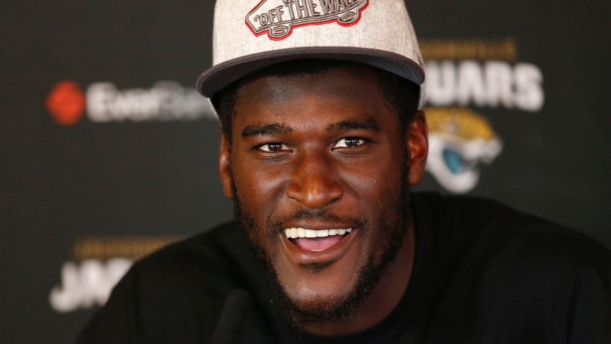 Jacksonville Jaguars' wide receiver Justin Blackmon speaks to the media during a press conference at the Pennyhill Park Hotel and Spa in Bagshot, England, Wednesday, Oct. 23, 2013. Jaguars play San Francisco 49ers on Sunday in a NFL football game at Wembley Stadium  in London. (AP Photo/Sang Tan)