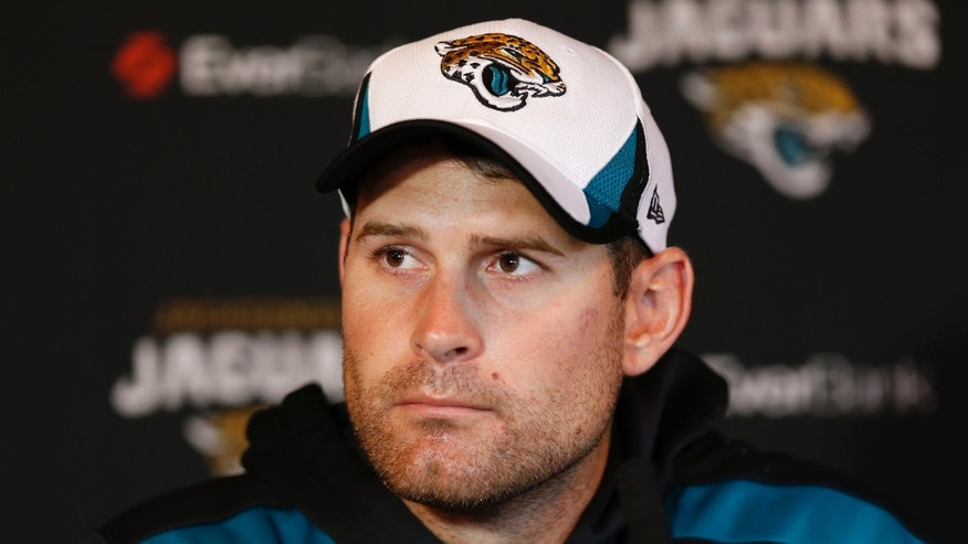 Jacksonville Jaguars' quarterback Chad Henne speaks to the media during a press conference at the Pennyhill Park Hotel and Spa in Bagshot, England, Wednesday, Oct. 23, 2013. Jaguars play San Francisco 49ers on Sunday in a NFL football game at Wembley Stadium  in London. (AP Photo/Sang Tan)