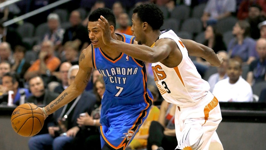Phoenix Suns' Ish Smith (3) defends against Oklahoma Thunder guard Diante Garrett  during the first half of an NBA preseason basketball game, Tuesday, Oct. 22, 2013, in Phoenix. (AP Photo/Matt York)