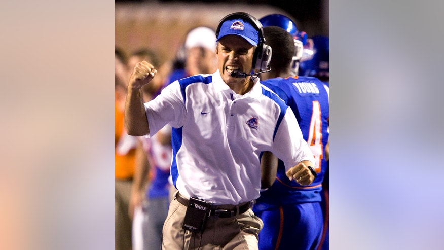FILE - In this Oct. 1, 2008, file photo, Boise State coach Chris Petersen celebrates after Boise State stopped Louisiana Tech on a fourth down during the second half of an NCAA college football game, in Boise, Idaho. When his team plays at BYU Friday night, Oct. 25, 2013, Petersen will be on the sidelines for his 100th game as head coach. (AP Photo/Matt Cilley, File)