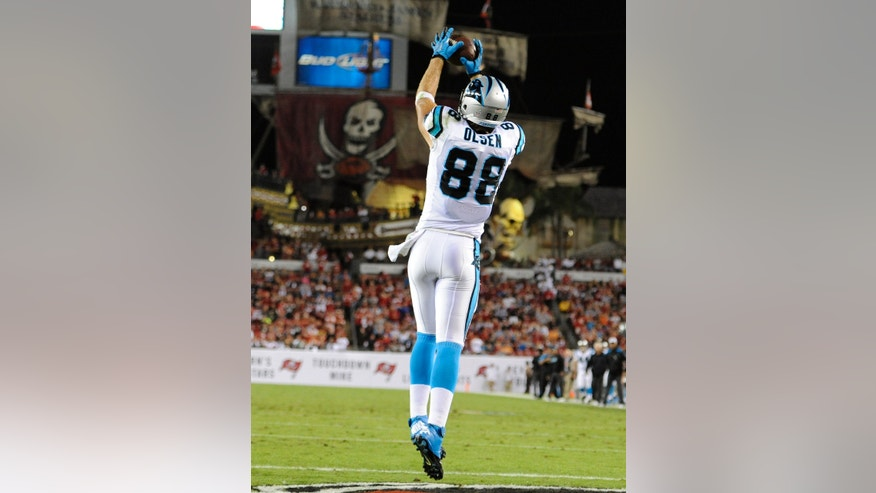 Carolina Panthers tight end Greg Olsen (88) pulls in a 1-yard touchdown reception during the first quarter of an NFL football game against the Tampa Bay Buccaneers, Thursday, Oct. 24, 2013, in Tampa, Fla. (AP Photo/Brian Blanco)