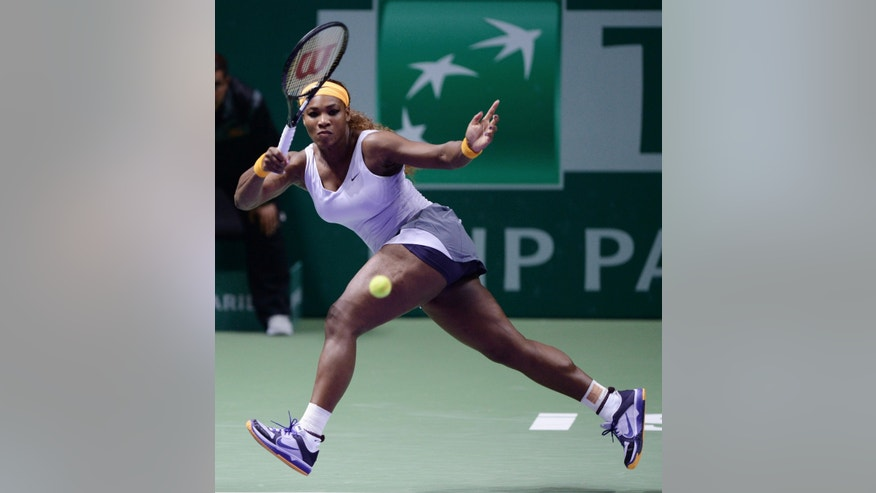 Serena Williams of the USA returns a shot to Petra Kvitova of Czech Republic during their tennis match at the WTA championship in Istanbul, Turkey, Thursday, Oct. 24, 2013. The world's top female tennis players compete in the championships which runs from Oct. 22 until Oct. 27.(AP Photo)