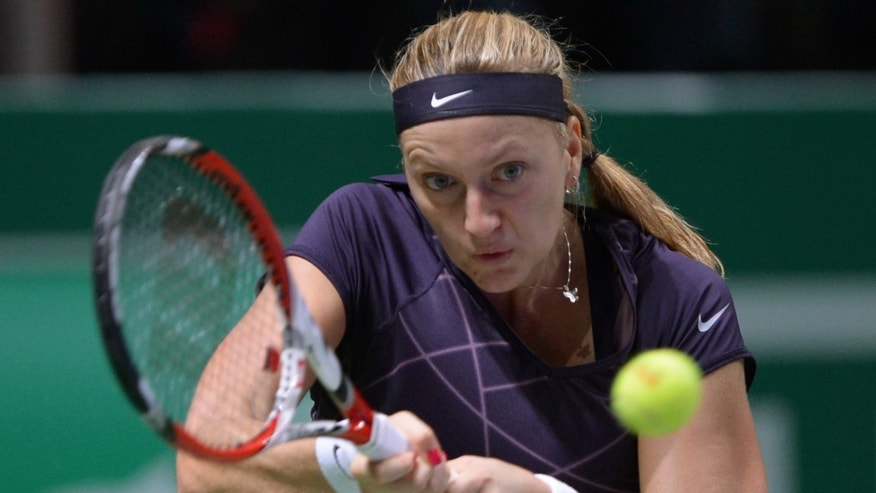 Petra Kvitova of Czech Republic returns a shot to Serena Williams of the USA during their tennis match at the WTA championship in Istanbul, Turkey, Thursday, Oct. 24, 2013. The world's top female tennis players compete in the championships which runs from Oct. 22 until Oct. 27.(AP Photo)