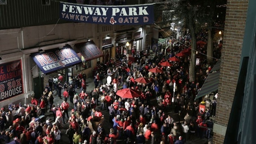 October 23, 2013: Fans make their way to Fenway Park before Game 1 of baseball's World Series between the Boston Red Sox and the St. Louis Cardinals in Boston. (AP Photo/Charlie Riedel)