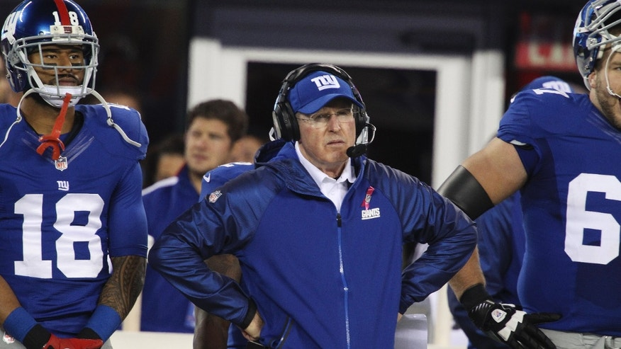 New York Giants head coach Tom Coughlin stands on the sidelines during the first half of an NFL football game against the Minnesota Vikings Monday, Oct. 21, 2013 in East Rutherford, N.J. (AP Photo/Peter Morgan)