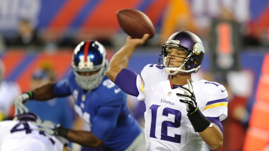 Minnesota Vikings quarterback Josh Freeman (12) throws a pass during the first half of an NFL football game against the New York Giants Monday, Oct. 21, 2013 in East Rutherford, N.J. (AP Photo/Bill Kostroun)