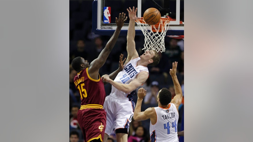 Charlotte Bobcats' Cody Zeller (40) blocks a shot by Cleveland Cavaliers' Anthony Bennett (15) in the first half of a preseason NBA basketball game in Charlotte, N.C., Thursday, Oct. 24, 2013. (AP Photo/Chuck Burton)