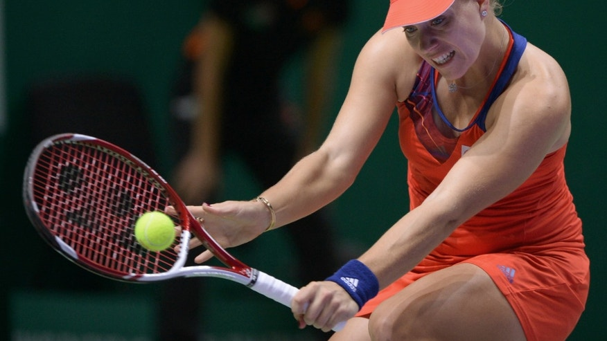 Angelique Kerber of Germany returns a shot to Agnieszka Radwanska of Poland during their tennis match at the WTA championship in Istanbul, Turkey, Thursday, Oct. 24, 2013. The world's top female tennis players compete in the championships which runs from Oct. 22 until Oct. 27. (AP Photo)